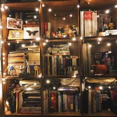 Fairy lights always manage to make everything look whimsical. | 24 Bookshelves That Will Mildly Arouse Any Book Lover