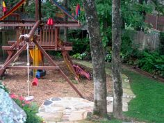 I like this combo of playground and grass around it. Playset with mulch and a bike track