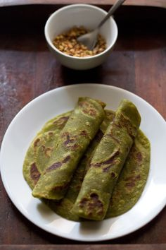 aloo palak paratha recipe with step by step photos. aloo palak paratha is an easy paratha recipe made with mashed potatoes, spinach puree and whole wheat flour. Aloo Recipes, Paratha Recipes, Flatbread Recipes, Veg Recipes, Cheese Recipes, Recipies, Dinner Recipes, Indian Snacks, Indian Food Recipes