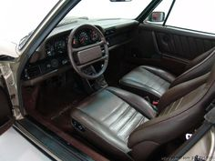 1986 PORSCHE 911 CARRERA TARGA | Dark brown leather interior. Great combination with the White Gold Metallic exterior.