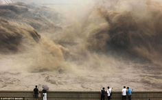Water being released from the Xiaolangdi dam to clear up the Yellow river to prevent localized flooding. Henan province, China, 2012