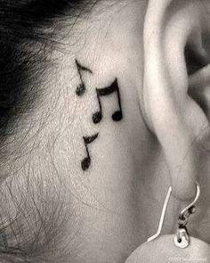 Music note tattoo behind ear.