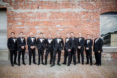Real Nashville Wedding at Scarritt Bennett captured by Amanda May Photos! Groom and groomsmen wearing our slim-fit black Ike Behar peak lapel tuxedos. #selectformalwear #blacktux #slimfit #classic #tuxedo #menswear #groomattire #groomsmenattire