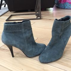 Calvin Klein booties Grey suede like booties. Not sure if they are real suede or not it doesn't say. 4 inch heels. The only mark on the boots is on the heel see photo. Calvin Klein Shoes Ankle Boots & Booties