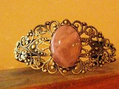 'Antiqued Brass and Genuine Rose Quartz' is going up for auction at  2pm Thu, Jun 21 with a starting bid of $5.