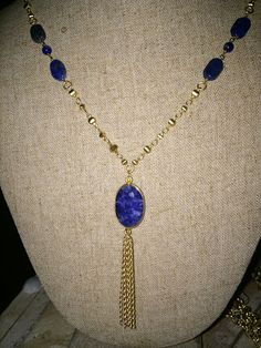 Betty Necklace - This beautiful necklace made of blue lapis features a beautiful tassel and dainty matte gold chain.  $88.00