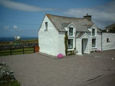 Cabin in Valentia Island, Ireland. Cul Cottage is a beautifully restored 200 year old Irish cottage. It is situated in an area of breath-taking scenery over looking Dingle Bay and the Blasket Islands on one side and Valentia harbour on the other. Close by you can view / visit (May ...
