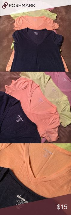 Old navy vintage v neck tee bundle All have been worn a few times and have some pilling besides the light navy blue one, it's like new. All are a size small. Colors from top to bottom are light pink, fluorescent yellow, light orange, and light navy blue Old Navy Tops Tees - Short Sleeve