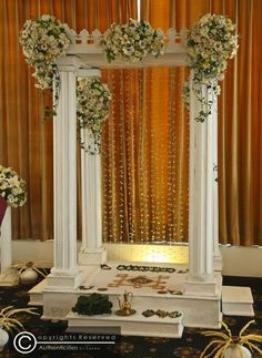 """the """"magul poruwa"""" is a simple stage designed for the couple. it is usually decorated with flowers and lighting to add colour"""