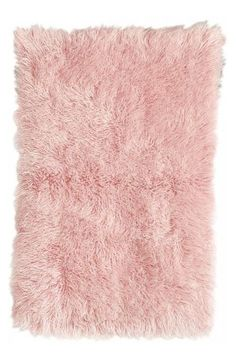 For Emma Rae! Pink is the ultimate girly-girl color! Layer this area rug over a rug pad to keep it in place in a bedroom over hardwoord floors.