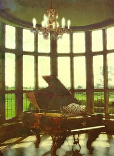 The perfect piano room. Love the idea of having a view outside any way I look!