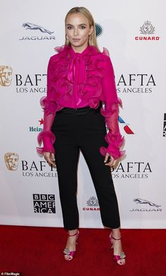 Comer exudes glamour at BAFTA event in LA - Jodie Comer exudes glamour in pink ruffled top and black trousers as she turns heads at BAFTA event -Jodie Comer exudes glamour at BAFTA event in LA - Jodie Comer exudes glamour in . Black Cropped Pants, Black Trousers, Pink Dress, Dress Up, Oversized White Shirt, Jodie Comer, Satin Midi Skirt, Valentino Dress, Sexy Blouse