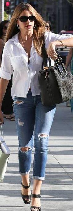 Who made  Sofía Vergara's white button down shirt, black platform sandals, black sunglasses, and leopard print handbag