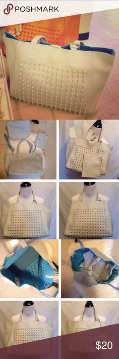 White & Turquoise Studded Tote Bag Made of soft faux leather material.  Magnetic snap closure. The main bag can be snapped in the middle to convert to a smaller size tote bag. Inside lining has a colorful contrast color.  Please review all photos, it'a the best representation of the item being sold.    Measurements in inches. Tote:17x10.5x6, 18w/strap Clutch:10x8.5x, strap from 27-49 Wristlet:7x5.5 Thank you. God bless you. J's Closet Bags Totes