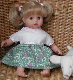 Dress detail for 12 inch and 13 inch baby dolls; Gotz Muffin; click image to buy Muffin at Amazon.com