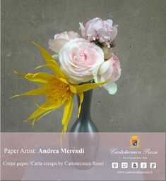 Here is an artist who amazes for its creativity and originality: Andrea Merendi. Andrea's flowers are not copies of the natural flowers, but they're new objects, small crepe paper art crafts.