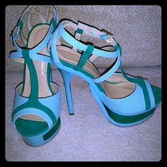 Tiffany blue and seagreen platform cutout heels Brand new never worn Tiffany Blue and Seagreen platform Heels with 1 inch cutout platform. Strappy back with x design and ankle strap. Tiffany blue material is a snakeskin print. Beautiful shoes with a fun edge. No trades Shoes Heels