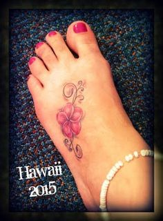 Plumeria with decoration.  This would go with the one I have across my upper back, except this one is pink.