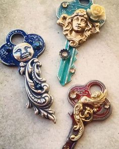 A trio of pendants made from painted and embellished old door keys - a fun way to use odd little charms and crystals!