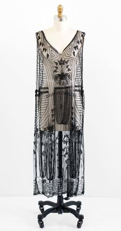 Tabard Flapper Over Dress: ca. 1920's, handmade (one-of-a-kind), sheer netting covered in heavy jet beading and studs.