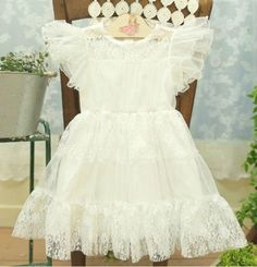 - Vintage inspired dress - Age: 3-8 years old - Available in pink and white - Delicate lace on shoulders - Lovely floral lace overlay - Beautiful floral lave around neck - Hidden back zipper closure - Soft and comfy fabrics - 100% cotton - Knee-Length - Machine Wash Cold - Imported  ...
