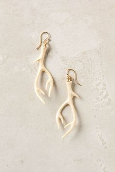 """Designed and hand-assembled in Extasia's California studio, this fossilized mammoth ivory pair was shaped into five-point antlers by master carvers in Bali.  - 14k gold fill, mammoth ivory - 2.75""""L, 1""""W - Handmade in USA"""