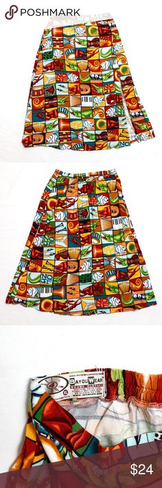 """Bayou Wear - Unique Longer Skirt This unique skirt features a mishmash of pictures...fish, lobsters, violins, tubas, crocodiles and more!  Truly unique.  Front slit, as pictured reaches up to about mid thigh (depending on how tall you are. I am 5'6"""". ).  Button front,  partial elastic waist in back. 100% rayon makes it soft and drapes nicely.  Tag says size is XL, but I usually wear a Med or Large (size 12) and it fits me with no extra in the waist.  See photo for measurements.  Fast shipper…"""