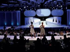 Creative runway staging that runs through the audience with steps on the main stage  for showcasing models.