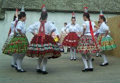 Folk dance with wine glasses--Google Image Result for http://m.blog.hu/ol/olomuveg/image/1228843230.jpg