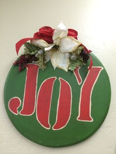 """JOY"" Christmas wall sign.  Handmade crafts created by adults with intellectual and developmental disabilities."
