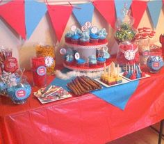 red/turquoise/white candy bark, cake balls, dipped pretzel rods, and rice krispy treats and colored popcorn blue.  I also made The Cat's Hat Marshmallow Pops!  From Texas Monkey