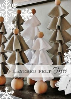 Easy simple way to make felt trees.  Create each tree with layers of felt and hot glue!  Simple idea for a Chirstmas mantel!  thistlewoodfarms.com
