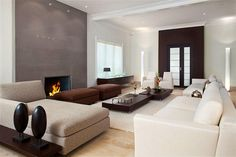 The neutral color palate and sleek design give this living room both a chic and tranquil ambiance.