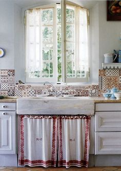 Love the curtain under sink and even the unmatching tiles as the backsplash.