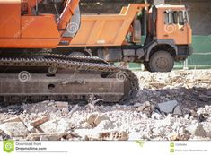 Track Excavator And Dump Truck Over Loads Of Rubble Debris Stock Photo - Image of building, demolition: 123092864 Construction, Dump Truck, Military Vehicles, Brick, Stock Photos, Building, Image, Army Vehicles, Buildings