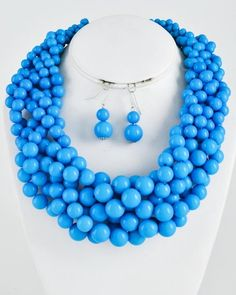 Strings of rich blue beaded twisted into statement necklace