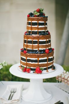 drip cake with berries