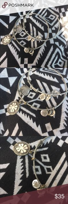 ALEX AND ANI 2 bracelet bundle, Seashell +Shamrock Two silver colored Alex and Ani bracelets. One has the seashell charm and one has the Shamrock charm. Made from recycled metals. Good shape, both could use a little polishing. Alex & Ani Jewelry Bracelets