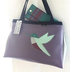 Loving the unexpected color mix on this custom Turbo tote and Blast wallet combo!   We'd love to feature your custom Holly Aiken! Tag it with #hollyaikencustom so we are sure to find it!  #hollyaikenbags #shopsmalldtraleigh #hummingbird #custombag