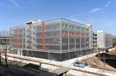 Parking Garage facade cladding with stainless steel wire mesh LARGO-NOVA 2035 by HAVER & BOECKER. The wire mesh ensures natural ventilation as well as natural lighting.