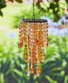 This decorative garden accent has the classy look of a chandelier and the peaceful musical notes of a wind chime. The acrylic crystal jewels hang at varied lengths around the chimes, reflecting in the