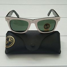 FIRM PRICE NWT RAY-BAN WAYFARER Authentic NWT RAY BAN WHITE WAYFARER RB 2140 956 50MM   ❌NO TRADES!  NOT POLARIZED   Description:  Unisex   Brand: Ray-Ban  Model: RB2140 956 Frame Color: White/Black Lens Color: Green  Lenses: Glass  Made In: Italy  SIZING (MM)  Lens Size: 50 Bridge Size: 22 Arm Length: 150  This item includes  OG Ray-Ban Box, case, microfiber cleaning cloth & booklets  100% Authentic Genuine Ray-Ban Sunglasses Ray-Ban Accessories Sunglasses