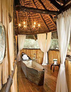 Tree house bath (canoe, lined with fiberglass serves as a tub)