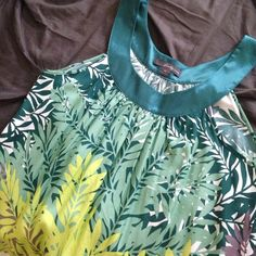 NWOT Forever 21 Shift Dress NWOT Floral Shift dress from Forever 21. Never worn. Light and airy with a gathered satiny neckline. Forever 21 Dresses