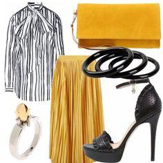 Questa sarà la stagione dei colori caldi, del colore del sole, perfetti anche per un outfit elegante come questo. Gonna plissè in senape, abbinata ad un'austera blusa a righe. Semplici ma dal gusto sbarazzino i gioielli!