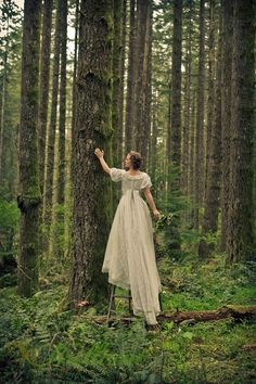 Silverfalls State Park Wedding Inspiration Stylized Shoot Dream Forest bride on a ladder in the woods - By Rachel Garcia of Brilliant Imagery, a boutique wedding photography studio specializing in destination weddings and creative trash the dress sessions.