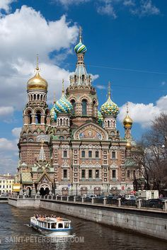 Church of Savior on the Spilled Blood with a Passing Tour Boat