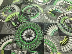 This striking quilt was made by Lou. I had a lot of fun quilting it, and enjoyed designing something special for the border....