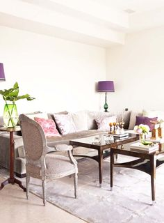 Pair of tables, velvet couch, and plum accents.