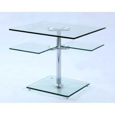 """Our Rose end table looks lovely paired with the clear rose cocktail table.  The end table has a square glass top, and a second tier for additional display or storage.  Table top or second tier do not swivel.   27.6"""" 27.6""""x 21.7"""""""